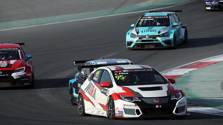 Josh Files battling to third place in race two with his M1RA Honda Civic. Picture: TCR International
