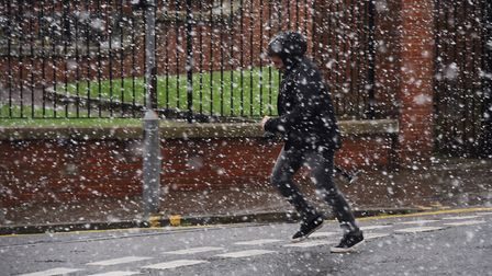 Snow showers in the city centre. Picture: DENISE BRADLEY