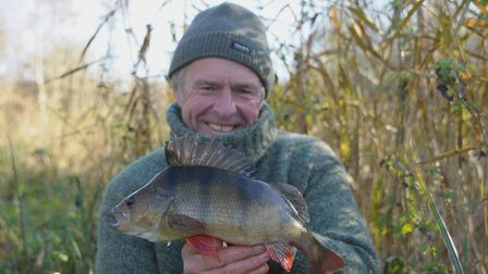 All wrapped up for winter, John Bailey holds a fine, bristling perch. Picture: John Bailey
