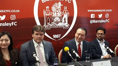 Barnsley's new owners Grace Hung (left). Paul Conway (second left) and Chien Lee (centre) during a p