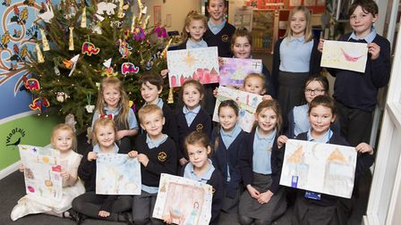 Youngsters from Worlingham Primary School and their Christmas pictures Picture: Nick Butcher