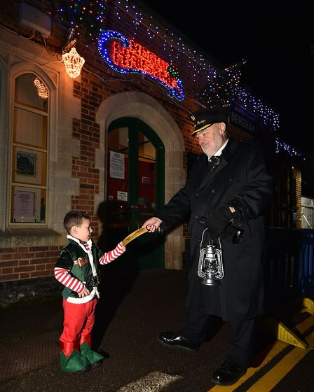 The Mid Norfolk Railway Polar Express. Toby Westrup, 4, handing over his ticket to the ticket master