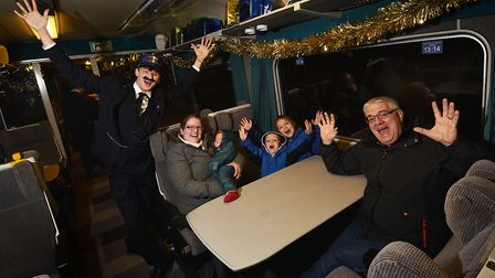 The Mid Norfolk Railway Polar Express. Shaun and Dannielle Sellwood, from New Zealand, with their ch