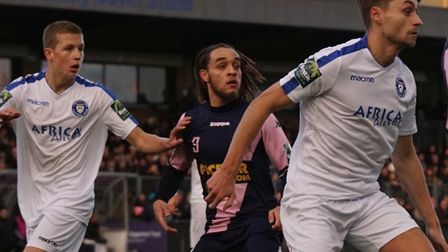 One-time reported Norwich City transfer target Reise Allassani, centre, in action for Dulwich Hamlet