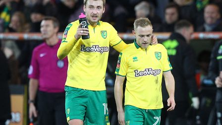 Tom Trybull and Alex Pritchard have a quick word during Norwich City's FA Cup clash with Chelsea at