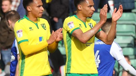 Josh, left, and Jacob Murphy applaud the Carrow Road crowd after last season's 1-1 draw with Ipswich
