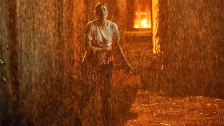 DI Elaine Renko (Agyness Deyn) flees from her burning house after suffering a violent attack (C) Eus