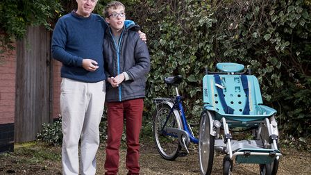 Chris Hill with his son Tobias,17, and the specially adapted disabled bike that was stolen and trash