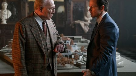 Christopher Plummer as John Paul Getty and Mark Wahlberg at Fletcher Chace in All The Money In The W