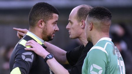 Referee Edward Pidduck speaks to Bromsgrove Sporting goalkeeper Reece Francis, who claimed he was ab