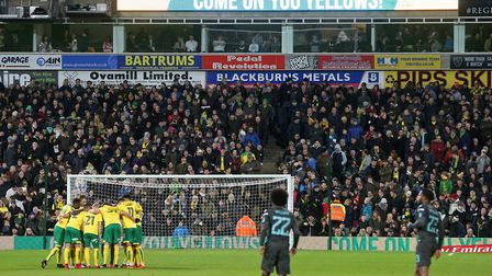 The Norwich players in the pre match huddle before the FA Cup match at Carrow Road, Norwich. Picture