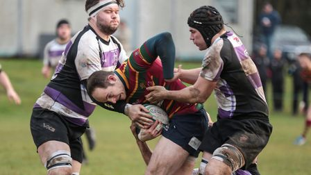 Theo Elliott attempts to force his way through during Norwich's win at Woodford. Picture: Andy Mickl