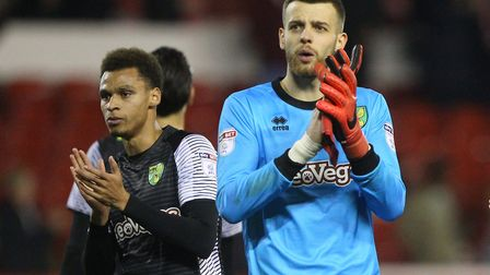 Josh Murphy and, Angus Gunn applaud the traveling support at the end of the Sky Bet Championship mat