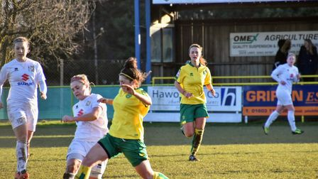 Norwich City's Kyla Love wins the ball with Jodie Drake against MK Dons. Picture: Brian Coombes