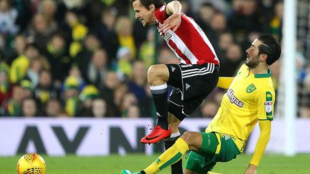 Mario Vrancic snaps at Lasse Vibe's heels at Brentford run out 2-1 winners over Norwich City at Carr