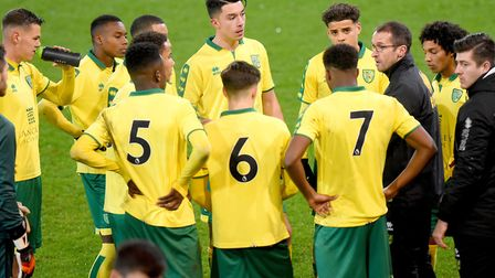 Norwich City U18s coach David Wright speaks to his players during a lengthy injury stoppage for a De