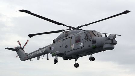 Royal Navy frigate, HMS Norfolk in the North Sea off the coast of East Anglia - The boats Lynx helic