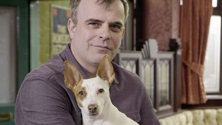 Pictured: Simon Gregson on the set of Coronation Street with dog Cookie who plays Rover. PIC ITV