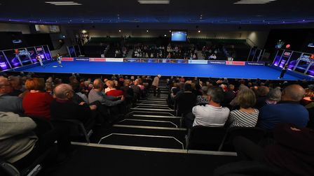A view from the stands of the World Indoor Singles Championship clash between Jamie Chestney (red) a