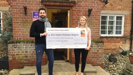 Dan Trivedi presenting Sophie Mayes with the cheque. Photo: EACH