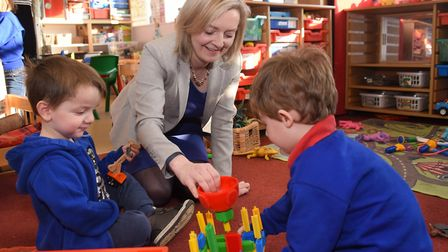 MP Liz Truss with Matthew McAllister, three, left, and Percy Smith, three, during her visit to the K