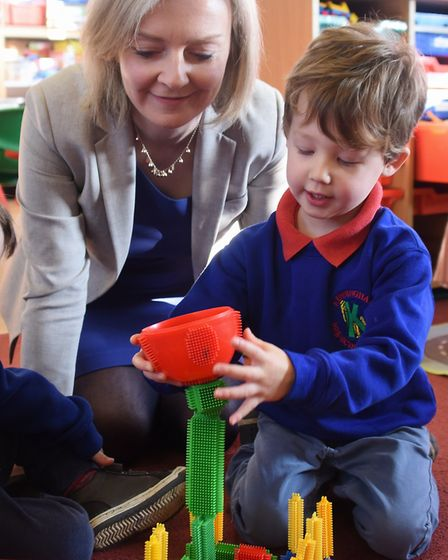 MP Liz Truss with Percy Smith, three, during her visit to the Kenninghall Pre-school Nursery, which