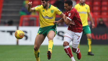 Nelson Oliveira battles with Korey Smith of Bristol City during the Sky Bet Championship match at As