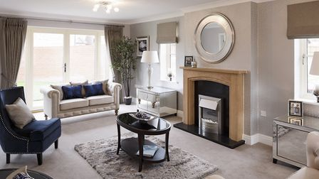 A typical living room by Bennett Homes