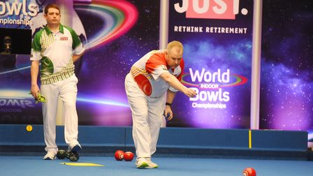 Singles action from the World Bowls Championships at Potters Leisure Resort as Graham Burnett (red)