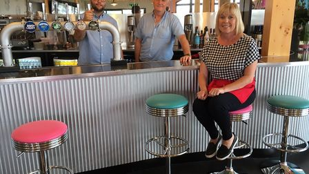 From left to right: Jamie Moore, Mark Eames and Mandy Eames at The Bridge American Restaurant. Pictu