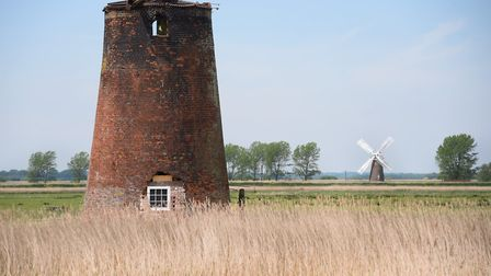 Two Norfolk Broads windmills on the River Yare between Cantley and Reedham, a derelict mill and the
