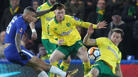 Christoph Zimmermann of Norwich blocks a shot on goal by Kenedy of Chelsea during the Third Round FA