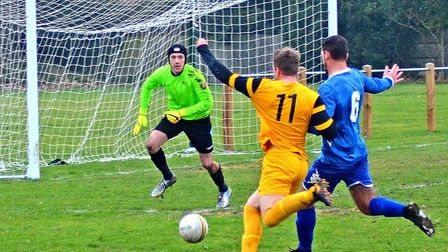 Waveney apply some pressure on what was a day to forget against Wroxham Reserves. Pictures: MICK HOW