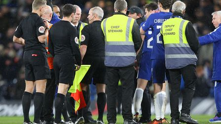 Chelsea manager Antonio Conte is in there somewhere, having approached referee Graham Scott at the e