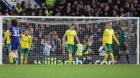 The Norwich players look dejected after conceding their sideÕs 1st goal during the Third Round FA Cu