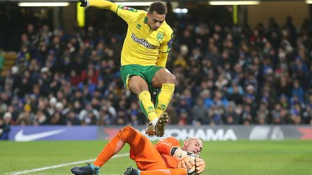Willy Caballero of Chelsea saves at the feet of Josh Murphy of Norwich during the Third Round FA Cup