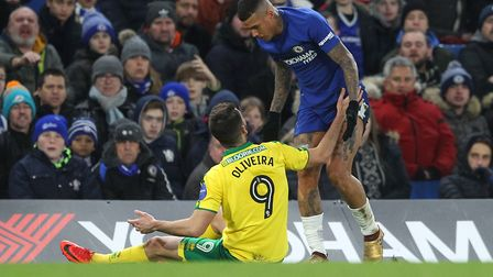 Nelson Oliveira of Norwich and Kenedy of Chelsea clash during the Third Round FA Cup Replay match at