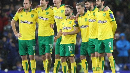The Norwich players look anxious as they watch the penalty shoot out during the Third Round FA Cup R