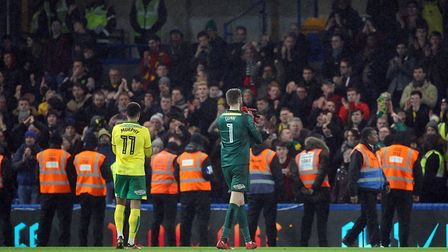 Josh Murphy of Norwich and Angus Gunn of Norwich at applaud the traveling support the end of the Thi