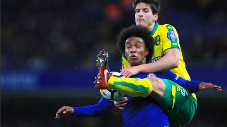 Timm Klose gets his foot in ahead of Chelsea's Brazilian star Willian. Picture: PA