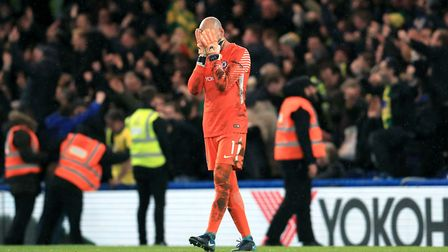 Chelsea goalkeeper Willy Caballero holds his head in his hands after Jamal Lewis' late equaliser. Pi