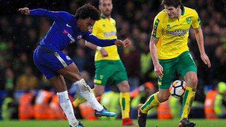 Timm Klose keeps a close eye on Willian. Picture: PA