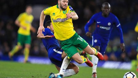 Wes Hoolahan skips away from Pedro, who was later sent off. Picture: PA