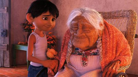 Miguel (voiced by Anthony Gonzalez) and his great-great-grandmother Mama Coco (Ana Ofelia Murguia) i