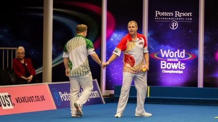 Rob Paxman, red, and Dan Salmon shake hands after their match at Potters. Picture: Mike Copestake Ph