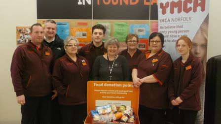 Sainsbury's Pound Lane's food donations partner YMCA at their store with colleagues. Photo Sainsbury