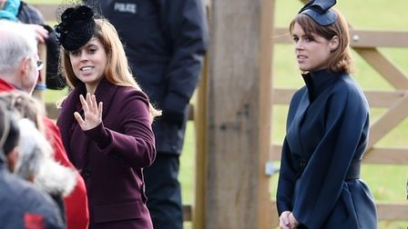 Princess Beatrice (left) and Princess Eugenie, leave after attending the morning church service at S