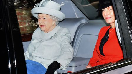Queen Elizabeth II leaves after attending the morning church service at St Mary Magdalene Church in