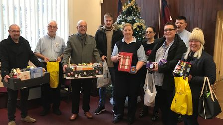 Staff from Great Yarmouth and Waveney Mind donating hampers to the Salvation Army. Picture: Great Ya