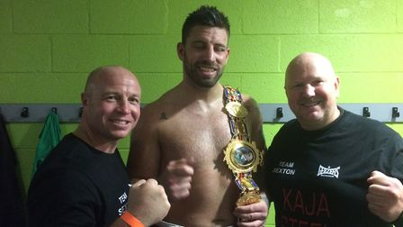 Sam Sexton, proud new owner of a British Championship belt with Graham Everett, right, and Jon Thaxt